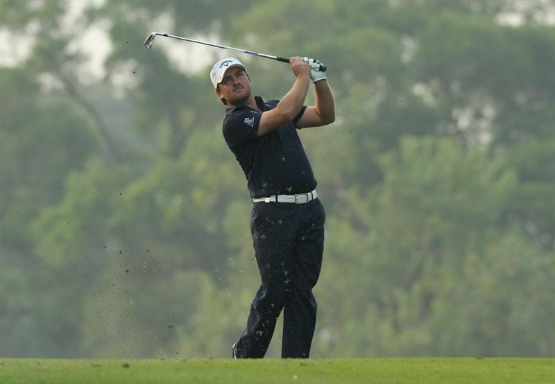 HONG KONG - NOVEMBER 19:  Graeme Mcdowell of Northern Ireland watches his 2nd shot on the 18th hole during day two of the UBS Hong Kong Open at The Hong Kong Golf Club on November 19, 2010 in Hong Kong, Hong Kong.  (Photo by Stanley Chou/Getty Images)