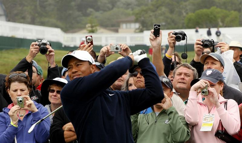 PEBBLE BEACH, CA - JUNE 14:  Patrons photograph Tiger Woods as he plays a tee shot during a practice round prior to the start of the 110th U.S. Open at Pebble Beach Golf Links on June 14, 2010 in Pebble Beach, California.  (Photo by Scott Halleran/Getty Images)