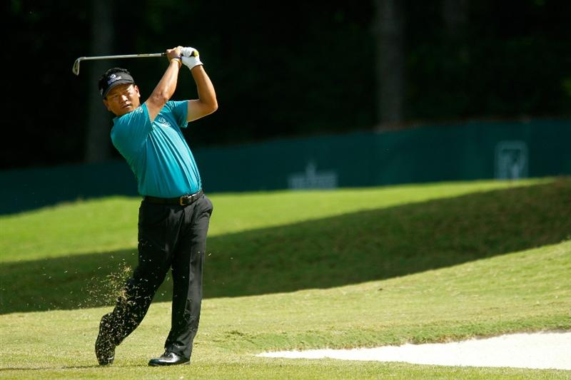 ATLANTA - SEPTEMBER 25:  K.J. Choi of South Korea hits his approach shot on the 16th hole during the third round of THE TOUR Championship presented by Coca-Cola at East Lake Golf Club on September 25, 2010 in Atlanta, Georgia.  (Photo by Scott Halleran/Getty Images)