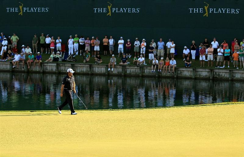 PONTE VEDRA BEACH, FL - MAY 15:  Graeme McDowell of Northern Ireland walks across the 18th hole during the final round of THE PLAYERS Championship held at THE PLAYERS Stadium course at TPC Sawgrass on May 15, 2011 in Ponte Vedra Beach, Florida.  (Photo by Streeter Lecka/Getty Images)