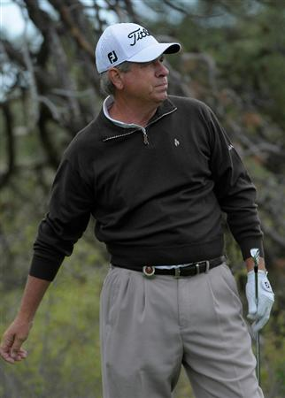 PARKER, CO. - MAY 27:  Robert Thompson tees off the 11th hole during the first round of the Senior PGA Championship at the Colorado Golf Club  on May 27, 2010 in Parker, Colorado.  (Photo by Marc Feldman/Getty Images)
