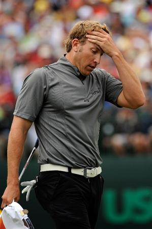 FARMINGDALE, NY - JUNE 22:  Ricky Barnes reacts on the 18th green after a missed birdie putt during the continuation of the final round of the 109th U.S. Open on the Black Course at Bethpage State Park on June 22, 2009 in Farmingdale, New York.  (Photo by Sam Greenwood/Getty Images)