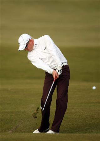 ST ANDREWS, SCOTLAND - OCTOBER 05:  Simon Dyson of England plays his second shot to the 16th hole during the final round of The Alfred Dunhill Links Championship at The Old Course on October 5, 2009 in St.Andrews, Scotland.  (Photo by Andrew Redington/Getty Images)