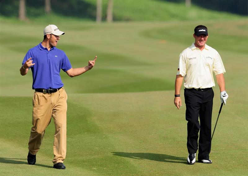 SHENZHEN, GUANGDONG - NOVEMBER 25:  Martin Kaymer and teamate Alex Cejka of Germany laugh during pro - am the Omega Mission Hills World Cup on the Olazabal course on November 25, 2009 in Shenzhen, China.  (Photo by Stuart Franklin/Getty Images)