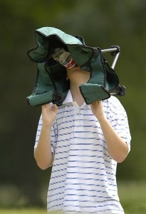 A young fan finds an innovative way to stay cool during the third round of the U.S. Bank Championship in Milwaukee at Brown Deer Park Golf Course in Milwaukee, Wisconsin, on July 29, 2006.Photo by Steve Levin/WireImage.com