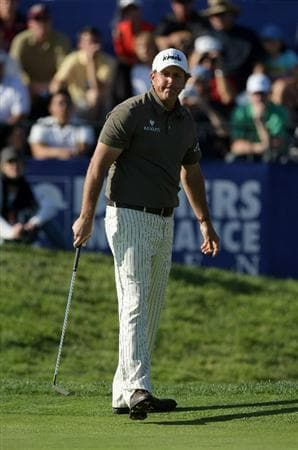 LA JOLLA, CA - JANUARY 29:  Phil Mickelson reacts to a missed birdie putt on the 18th hole during Round 3 of the Farmers Insurance Open at Torrey Pines on January 29, 2011 in La Jolla, California. (Photo by Donald Miralle/Getty Images)