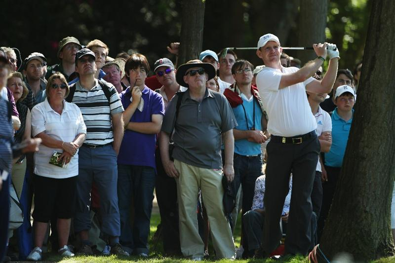 VIRGINIA WATER, ENGLAND - MAY 22:  Stephen Gallacher of Scotland plays from the rough during the third round of the BMW PGA Championship on the West Course at Wentworth on May 22, 2010 in Virginia Water, England.  (Photo by Andrew Redington/Getty Images)