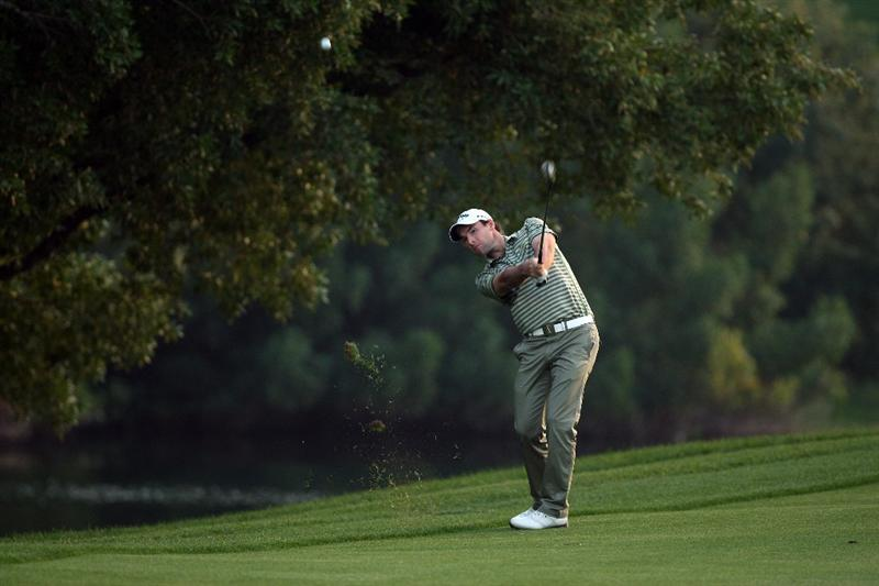 DUBAI, UNITED ARAB EMIRATES - JANUARY 30:  Oliver Wilson of England hits his second shot at the 2nd hole during the second round of the 2009 Dubai Desert Classic on the Majilis Course at the Emirates Golf Club on January 30, 2009 in Dubai, United Arab Emirates  (Photo by David Cannon/Getty Images)