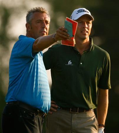 CHASKA, MN - AUGUST 11:  Soren Hansen of Denmark (R) talks over a shot with his caddie during the second preview day of the 91st PGA Championship at Hazeltine Golf Club on August 11, 2009 in Chaska, Minnesota.  (Photo by Scott Halleran/Getty Images)