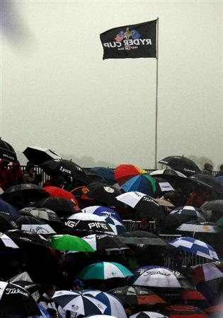 NEWPORT, WALES - OCTOBER 01:  Fans wait under umbrellas during the Morning Fourball Matches during the 2010 Ryder Cup at the Celtic Manor Resort on October 1, 2010 in Newport, Wales.  (Photo by Sam Greenwood/Getty Images)
