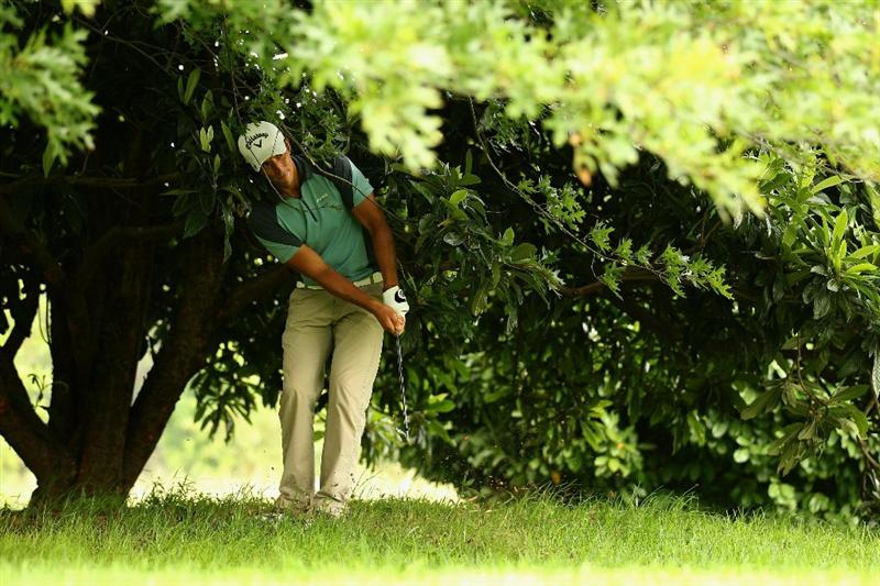 JOHANNESBURG, SOUTH AFRICA - JANUARY 15:  Jamie Elson of England plays out from under a tree on the first hole during the third round of the Joburg Open at Royal Johannesburg and Kensington Golf Club on January 15, 2011 in Johannesburg, South Africa.  (Photo by Warren Little/Getty Images)