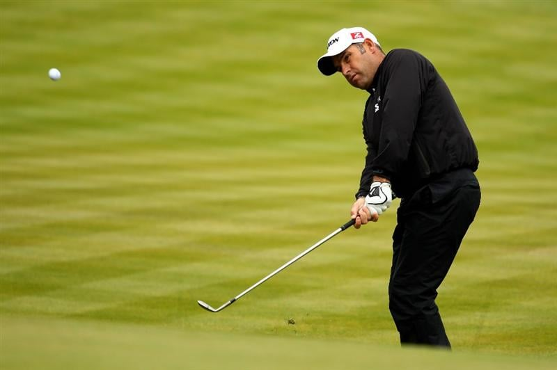 VIRGINIA WATER, ENGLAND - MAY 27:  Hennie Otto of South Africa chips to the 18th green during the second round of the BMW PGA Championship at the Wentworth Club on May 27, 2011 in Virginia Water, England.  (Photo by Richard Heathcote/Getty Images)