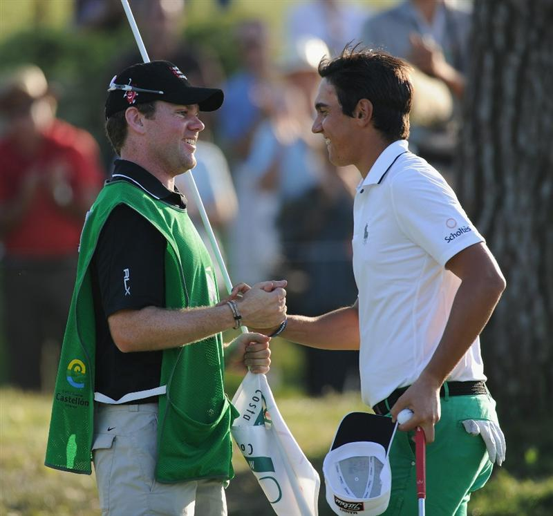 CASTELLON DE LA PLANA, SPAIN - OCTOBER 24:  Matteo Manassero of Italy celebrates with his caddie, Ryan McGuigan on the 18th hole during the final round of the Castello Masters Costa Azahar at the Club de Campo del Mediterraneo on October 24, 2010 in Castellon de la Plana, Spain.  (Photo by Stuart Franklin/Getty Images)