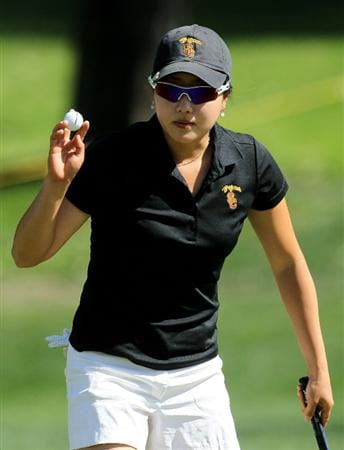 RANCHO MIRAGE, CA - APRIL 02:  Amateur Jennifer Song holds up her ball after making a birdie putt on the 11th hole during the second round of the Kraft Nabisco Championship at Mission Hills Country Club on April 2, 2010 in Rancho Mirage, California.  (Photo by Stephen Dunn/Getty Images)