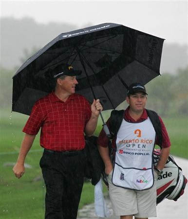RIO GRANDE, PR - MARCH 12:  Michael Bradley (L), the defending champion, leaves the golf course as play is suspended during the continuation of the first round of the Puerto Rico Open presented by Banco Popular at Trump International Golf Club held on March 12, 2010 in Rio Grande, Puerto Rico.  (Photo by Michael Cohen/Getty Images)