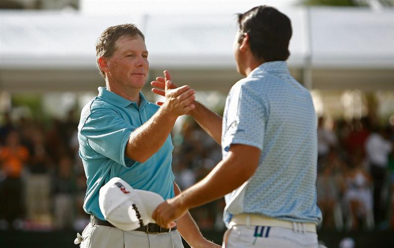 RIO GRANDE, PR - MARCH 15:  Michael Bradley hugs Jason Day after winning the 2009 Puerto Rico Open presented by Banco Popular at the Trump International Golf Club on March 15, 2009 in Rio Grande, Puerto Rico.  (Photo by Mike Ehrmann/Getty Images)