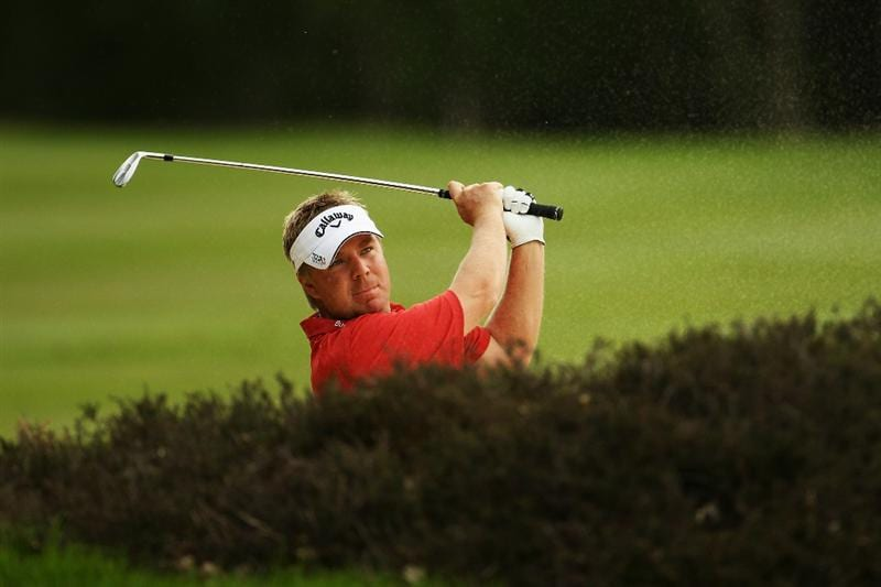 VIRGINIA WATER, ENGLAND - MAY 20:  Ross McGowan of England plays an iron shot during the first round of the BMW PGA Championship on the West Course at Wentworth on May 20, 2010 in Virginia Water, England.  (Photo by Ian Walton/Getty Images)
