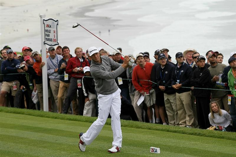 PEBBLE BEACH, CA - JUNE 18:  Dustin Johnson watches his tee shot on the 14th hole during the second round of the 110th U.S. Open at Pebble Beach Golf Links on June 18, 2010 in Pebble Beach, California.  (Photo by Stephen Dunn/Getty Images)