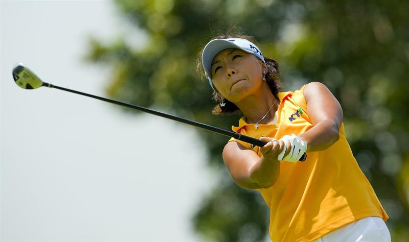 SINGAPORE - MARCH 06:  Mi Hyun Kim of South Korea watches her shot during the second round of HSBC Women's Champions at the Tanah Merah Country Club on March 6, 2009 in Singapore.  (Photo by Victor Fraile/Getty Images)
