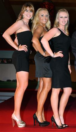 SINGAPORE - MARCH 04:  Paula Creamer, Natalie Gulbis and Morgan Pressel of the USA on the catwalk at the 'Welcolm Reception' prior to the HSBC Women's Championship at the Tanah Merah Country Club on March 4, 2009 in Singapore.  (Photo by Ross Kinnaird/Getty Images)