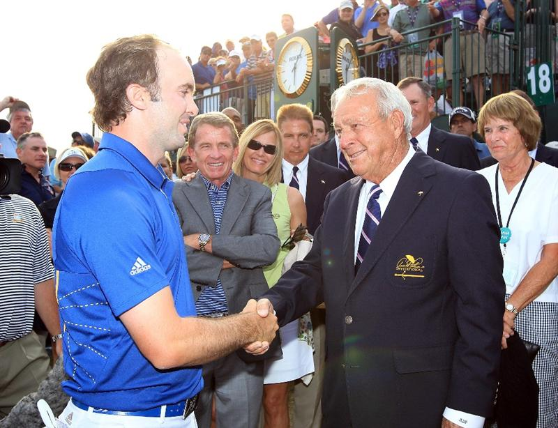 ORLANDO, FL - MARCH 27:  Martin Laird of Scotland is greeted by Arnold Palmer of the USA after he had secured victory on the 18th green during the final round of the 2011 Arnold Palmer Invitational presented by Mastercard at the Bay Hill Lodge and Country Club on March 27, 2011 in Orlando, Florida.  (Photo by David Cannon/Getty Images)