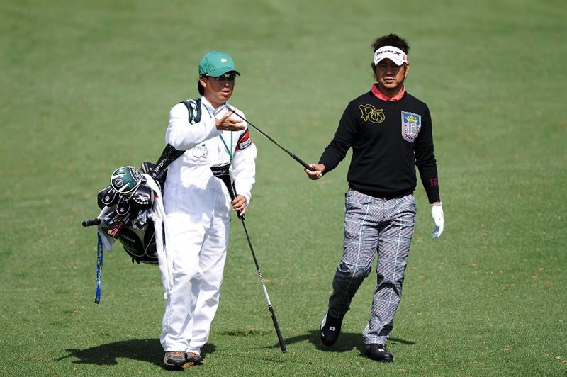 AUGUSTA, GA - APRIL 05:  Hiroyuki Fujita of Japan walks with his caddie Atsushi Umehara during a practice round prior to the 2011 Masters Tournament at Augusta National Golf Club on April 5, 2011 in Augusta, Georgia.  (Photo by Harry How/Getty Images)