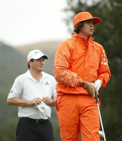 SAN MARTIN, CA - OCTOBER 17:  Rickie Fowler makes a tee shot on the second hole as Tim Clark of South Africa looks on during the final round of the Frys.com Open at the CordeValle Golf Club on October 17, 2010 in San Martin, California.  (Photo by Robert Laberge/Getty Images)