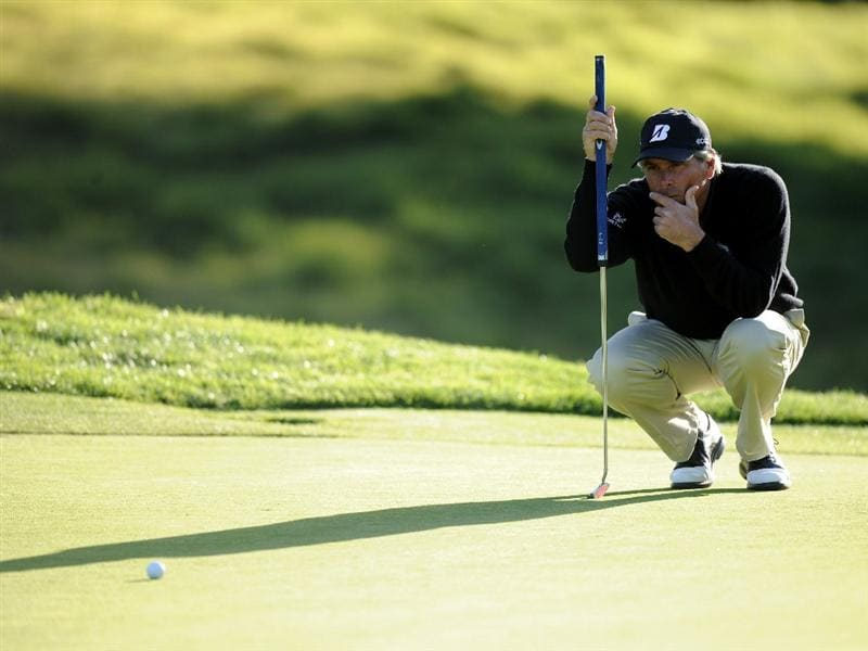 PACIFIC PALISADES, CA - FEBRUARY 17:  Fred Couples lines up a putt on the seventh hole during the first round of the Northern Trust Open at the Riviera Country Club on February 17, 2011 in Pacific Palisades, California.  (Photo by Harry How/Getty Images)