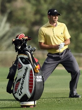 DUBAI, UNITED ARAB EMIRATES - FEBRUARY 02:  Sergio Garcia of Spain stretches on the fairway at the 18th hole during the third round of the Dubai Desert Classic, on the Majilis Course at the Emirates Golf Club, on February 2, 2008 in Dubai, United Arab Emirates.  (Photo by David Cannon/Getty Images)