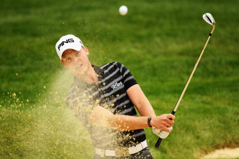 VIRGINIA WATER, ENGLAND - MAY 20:  Danny Willett of England plays out of a bunker on the 11th hole during the first round of the BMW PGA Championship on the West Course at Wentworth on May 20, 2010 in Virginia Water, England.  (Photo by Ross Kinnaird/Getty Images)
