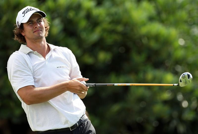 KAPALUA, HI - JANUARY 08:  Adam Scott of Australia plays a shot during the first round of the Mercedes-Benz Championship at the Plantation Course on January 8, 2009 in Kapalua, Maui, Hawaii.  (Photo by Sam Greenwood/Getty Images)