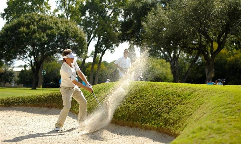 SAN ANTONIO - OCTOBER 25:  Bernhard Langer of Germany makes a shot out of a bunker on the 12th hole during the final round of the PGA Champions Tour AT&T Championship at the Oak Hills Country Club on October 25, 2009 in San Antonio, Texas.  (Photo by Robert Laberge/Getty Images)