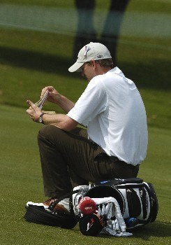 Tom Gillis waits for play on the ninth  hole during  final-round competition March 6, 2005  at the Ford Championship at Doral in Miami.