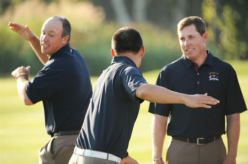 LOUISVILLE, KY - SEPTEMBER 17:  Boo Weekley, Anthony Kim and Justin Leonard of the USA team joke around during the USA team photo shoot prior to the 2008 Ryder Cup at Valhalla Golf Club on September 17, 2008 in Louisville, Kentucky.  (Photo by Harry How/Getty Images)