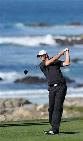 PEBBLE BEACH, CA - FEBRUARY 10:  Dustin Johnson plays a shot during the first round of the AT&T Pebble Beach National Pro-Am at Monterey Peninsula Country Club on February 10, 2011  in Pebble Beach, California.  (Photo by Stuart Franklin/Getty Images)