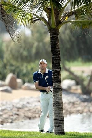 ABU DHABI, UNITED ARAB EMIRATES - JANUARY 21:  Oliver Wilson of England hits his second shot on the ninth hole during the first round of The Abu Dhabi Golf Championship at Abu Dhabi Golf Club on January 21, 2010 in Abu Dhabi, United Arab Emirates.  (Photo by Andrew Redington/Getty Images)