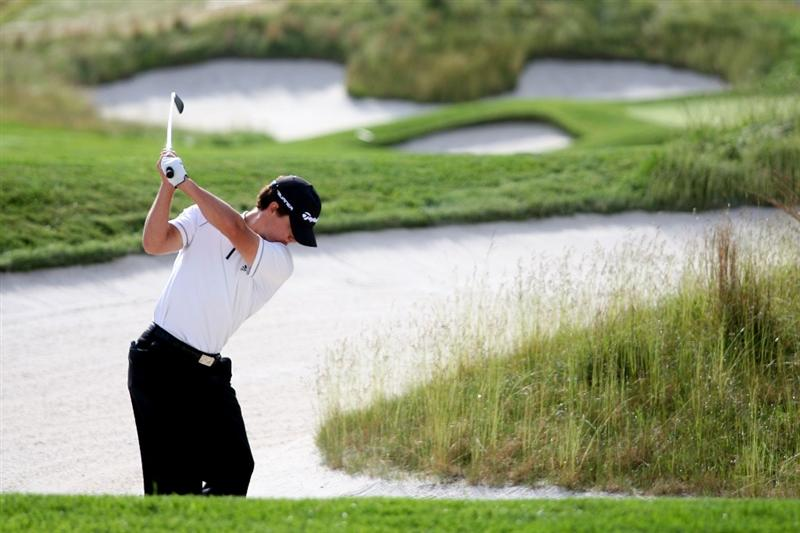 FARMINGDALE, NY - JUNE 17:  Casey Wittenberg hits a shot during the third day of previews to the 109th U.S. Open on the Black Course at Bethpage State Park on June 17, 2009 in Farmingdale, New York.  (Photo by Ross Kinnaird/Getty Images)