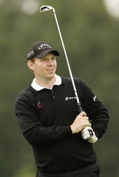 Stephen Gallacher watches his tee shot during the rain delayed third  round of the 2005 Deutsche Bank Players' Championship at Gut Kaden Golf Club. July 24, 2005Photo by Pete Fontaine/WireImage.com
