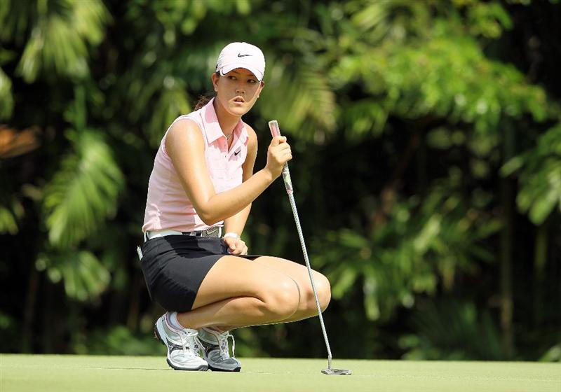 SINGAPORE - FEBRUARY 25:  Michelle Wie of the USA lines up a  birdie putt on the 4th hole during the first round of the HSBC Women's Champions at Tanah Merah Country Club on February 25, 2010 in Singapore, Singapore.  (Photo by Andy Lyons/Getty Images)