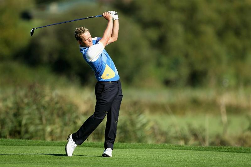 NEWPORT, WALES - OCTOBER 04:  Luke Donald of Europe hits a shot on the ninth hole in the singles matches during the 2010 Ryder Cup at the Celtic Manor Resort on October 4, 2010 in Newport, Wales.  (Photo by Andy Lyons/Getty Images)
