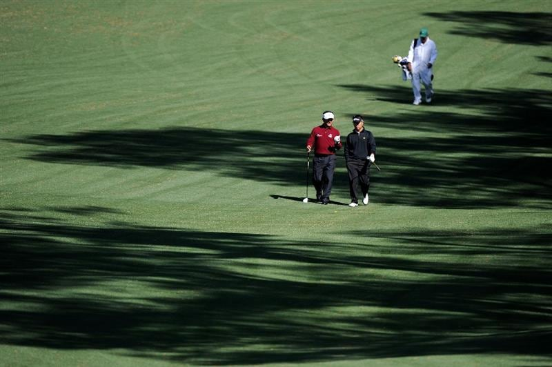 AUGUSTA, GA - APRIL 05:  Amateur Lion Kim walks with K.J. Choi of South Korea down a fairway during a practice round prior to the 2011 Masters Tournament at Augusta National Golf Club on April 5, 2011 in Augusta, Georgia.  (Photo by Harry How/Getty Images)