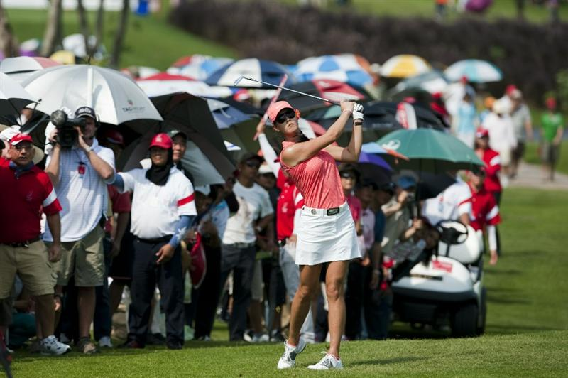 CHON BURI, THAILAND - FEBRUARY 20:  Michelle Wie of USA plays  her second shot on the 11th hole during day four of the LPGA Thailand at Siam Country Club on February 20, 2011 in Chon Buri, Thailand.  (Photo by Victor Fraile/Getty Images)
