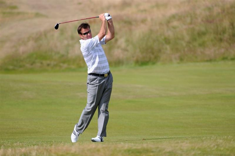TURNBERRY, SCOTLAND - JULY 16:  Sir Nick Faldo of England hits an approach shot during round one of the 138th Open Championship on the Ailsa Course, Turnberry Golf Club on July 16, 2009 in Turnberry, Scotland.  (Photo by Harry How/Getty Images)