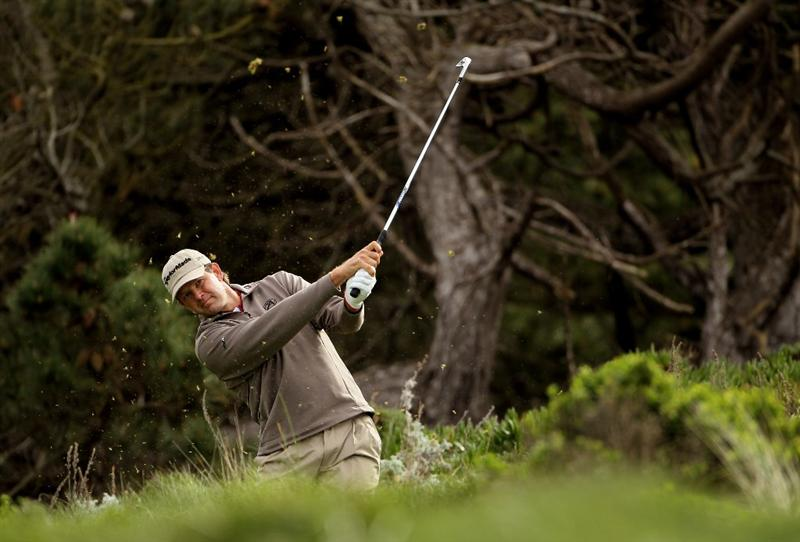 PEBBLE BEACH, CA - FEBRUARY 11:  Retief Goosen of South Africa tees off on the third hole during the first round of the AT&T Pebble Beach National Pro-Am at at the Spyglass Hill Golf Course on February 11, 2010 in Pebble Beach, California.  (Photo by Ezra Shaw/Getty Images)