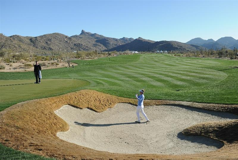MARANA, AZ - FEBRUARY 22:  Luke Donald of England plays a bunker shot during practice prior to the start of the World Golf Championships-Accenture Match Play Championship held at The Ritz-Carlton Golf Club, Dove Mountain on February 22, 2011 in Marana, Arizona.  (Photo by Stuart Franklin/Getty Images)