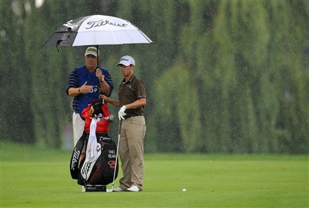 OAKVILLE, ON - JULY 26:  Chez Reavie sets up for an approach shot on the first hole as his caddie looks on during the third round of the RBC Canadian Open at the Glen Abbey Golf Club on July 26, 2008 in Oakville, Ontario, Canada. (Photo by Robert Laberge/Getty Images)