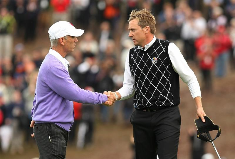NEWPORT, WALES - OCTOBER 02:  USA Team Captain Corey Pavin shakes hands with Ian Poulter of Europe during the rescheduled Afternoon Foursome Matches during the 2010 Ryder Cup at the Celtic Manor Resort on October 2, 2010 in Newport, Wales. (Photo by Ross Kinnaird/Getty Images)