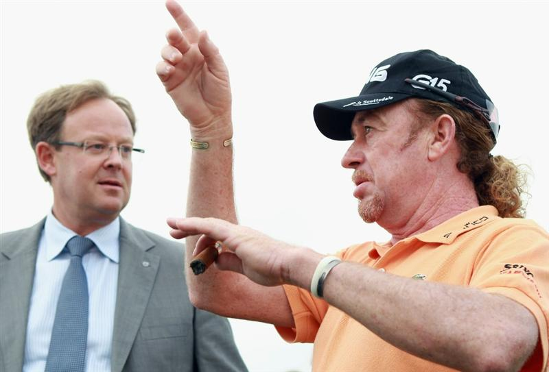 BAHRAIN, BAHRAIN - JANUARY 25:  Miguel Angel Jimenez of Spain (right) chats with Per Ericsson, President of Volvo Event Management Golf, during practice for the Volvo Golf Champions at The Royal Golf Club on January 25, 2011 in Bahrain, Bahrain.  (Photo by Andrew Redington/Getty Images)