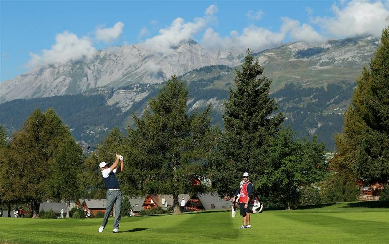 CRANS, SWITZERLAND - SEPTEMBER 03:  Greg Norman of Australia plays his second shot into the 15th green during the second round of The Omega European Masters at Crans-Sur-Sierre Golf Club on September 3, 2010 in Crans Montana, Switzerland.  (Photo by Warren Little/Getty Images)