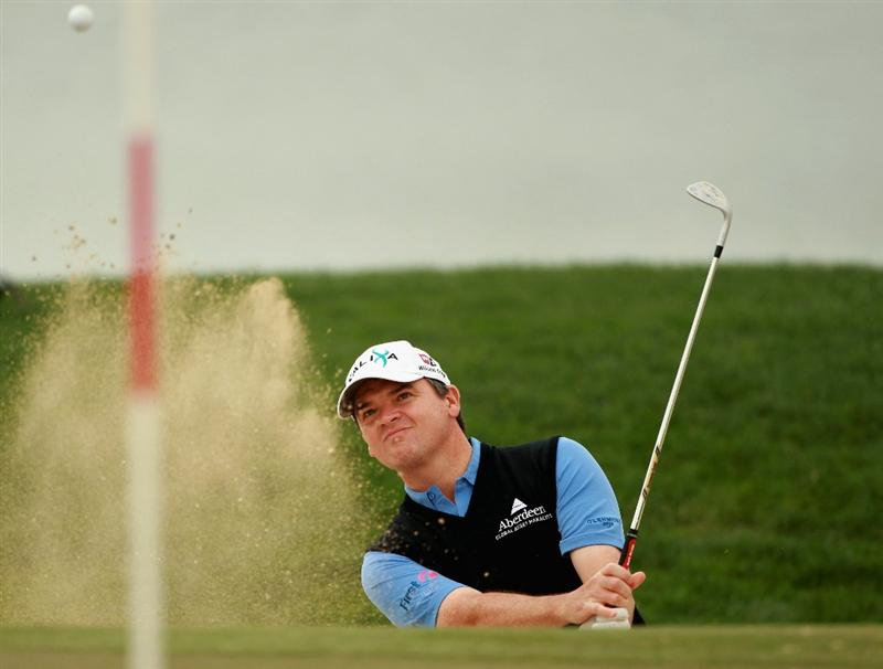 ABU DHABI, UNITED ARAB EMIRATES - JANUARY 19:  Paul Lawrie of Scotland in action during the Pro Am prior to the start of The Abu Dhabi HSBC Golf Championship at Abu Dhabi Golf Club on on January 19, 2011 in Abu Dhabi, United Arab Emirates.  (Photo by Andrew Redington/Getty Images)